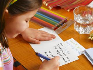1B5669101-tdy-130122-kid-writing-letter.blocks_desktop_small